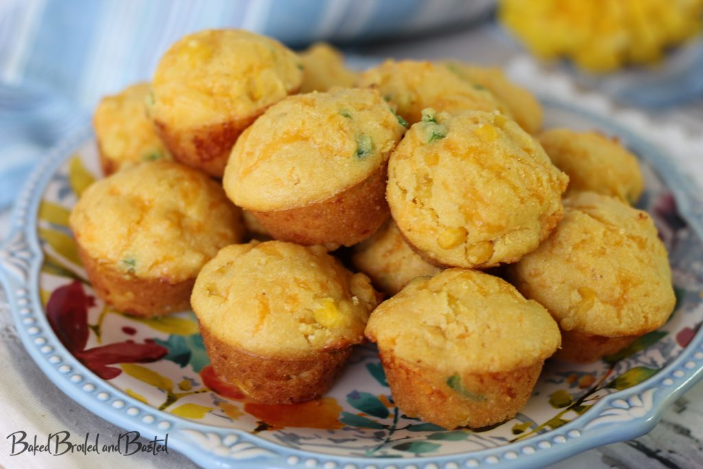 A plate full of Cheddar Jalapeno Cornbread Muffins