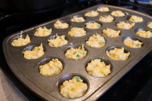 muffin tin full of Cheddar Jalapeno Cornbread Muffins