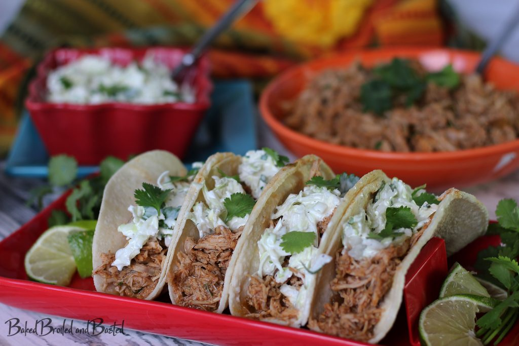 Cilantro Lime Pulled Pork Tacos on a red platter