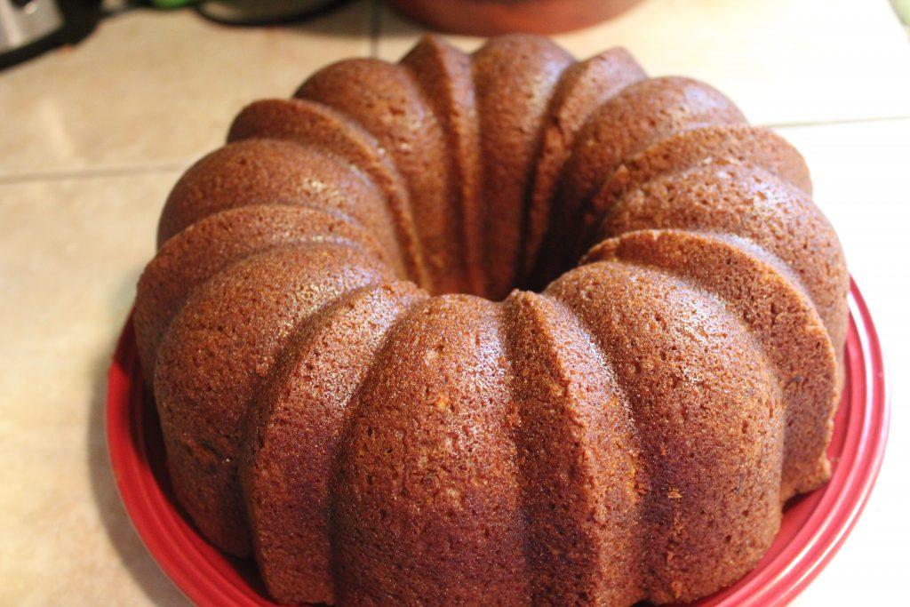 Apple Bundt Cake cooling on plate