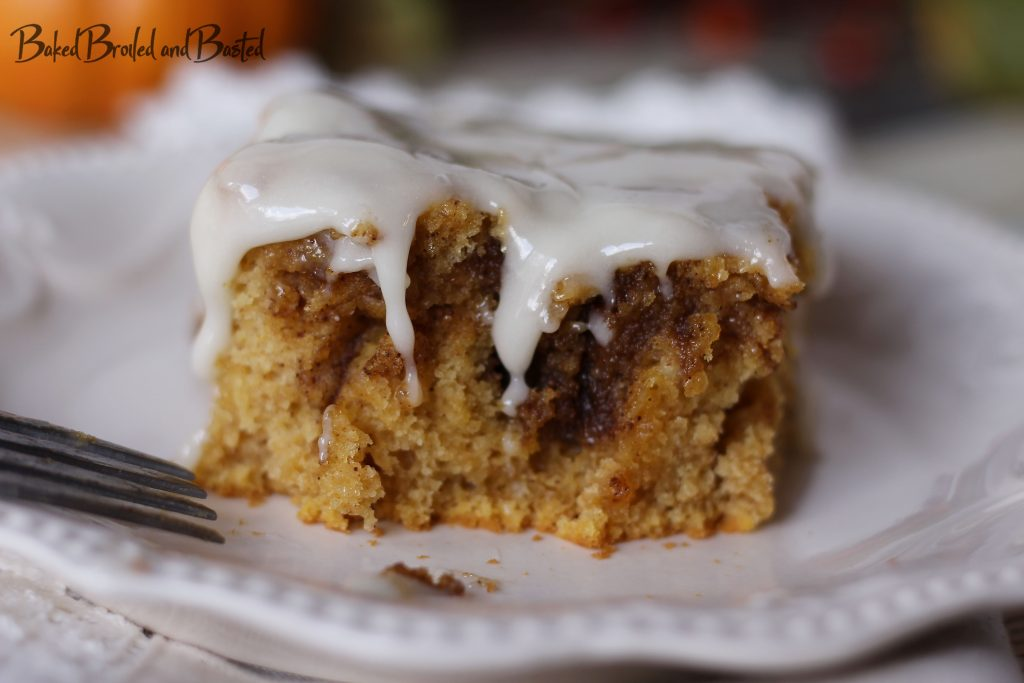 Pumpkin Spiced Cinnamon roll cake with a bite taken from it.