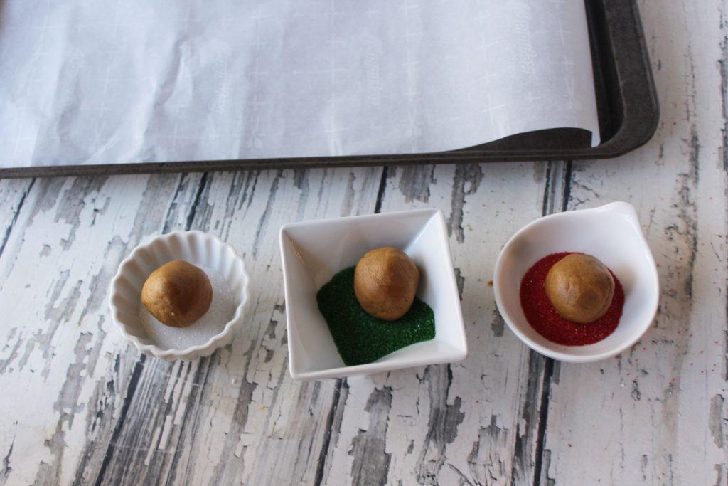 Rolling dough balls in colored sugar
