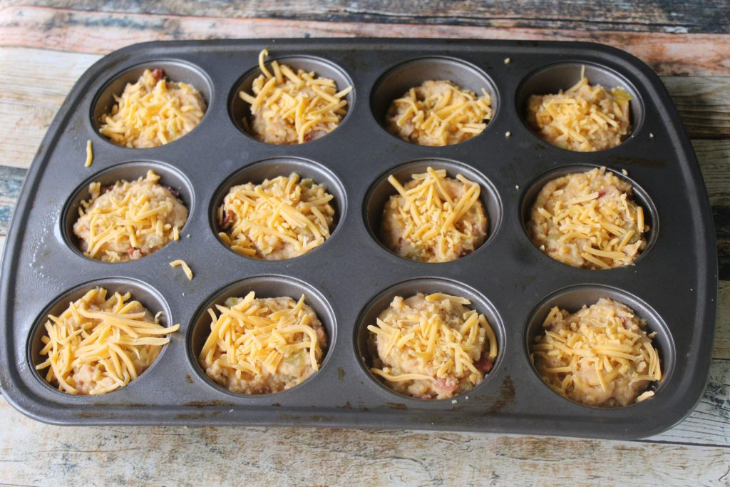 place mixture to muffin pan and top with cheese