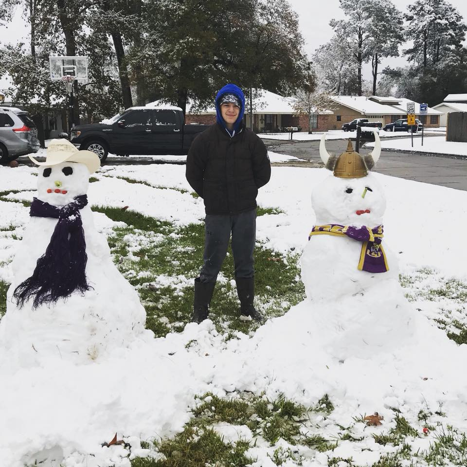 Boy and two snowmen