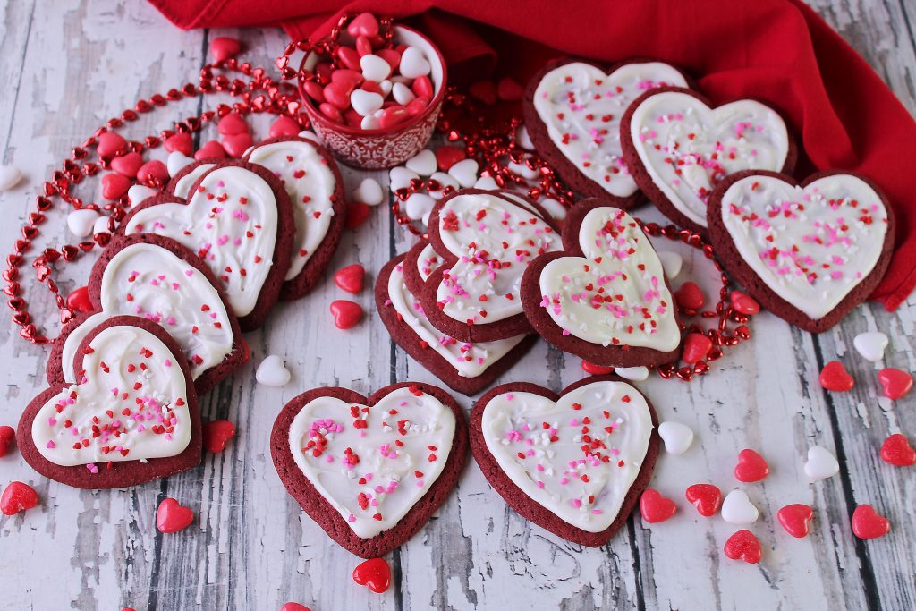 Several Red Velvet Heart Cookies on a table.