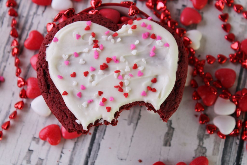 Bite taken out of Red Velvet heart cookie
