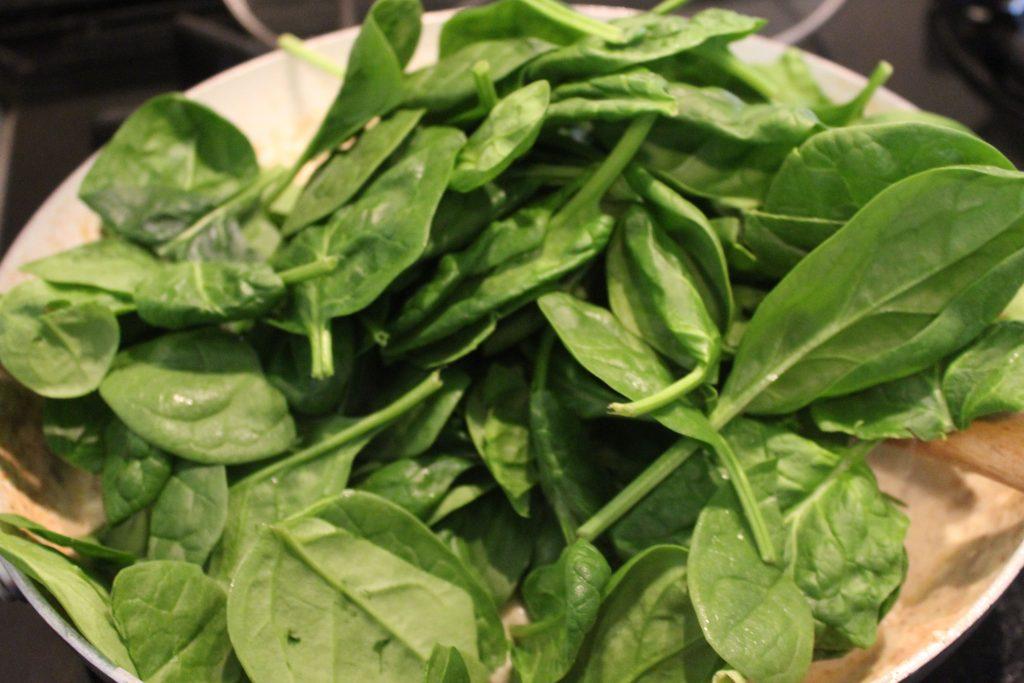 adding fresh spincah