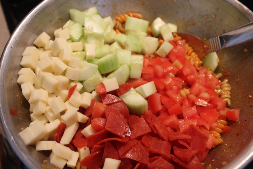 adding cheese ,cucumber and turkey roni