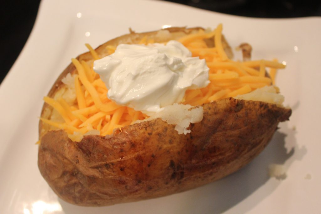 Baked potato cooked with sour cream and cheese