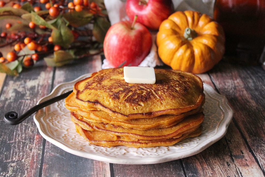 Spiced Pumpkin Apple Pancakes on a plate with a pat of butter