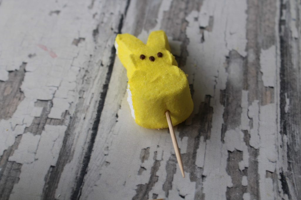 placing a toothpick in the peep