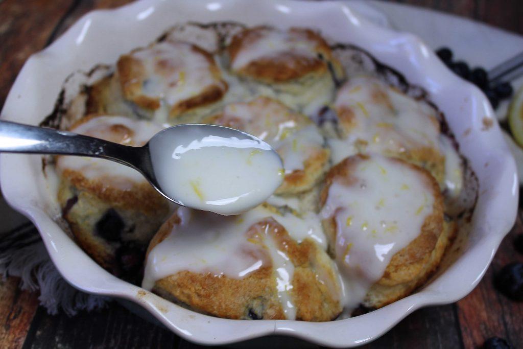lemon glaze on blueberry biscuits