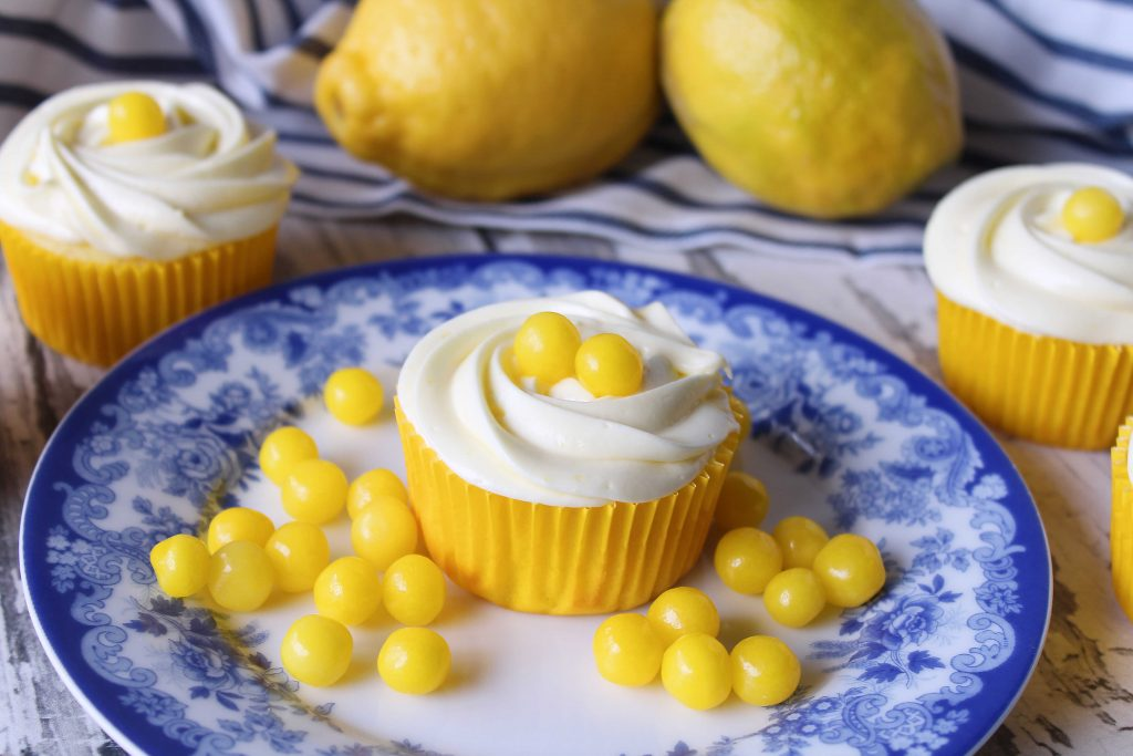 lemon cupcakes on a blue plate with lemon heads