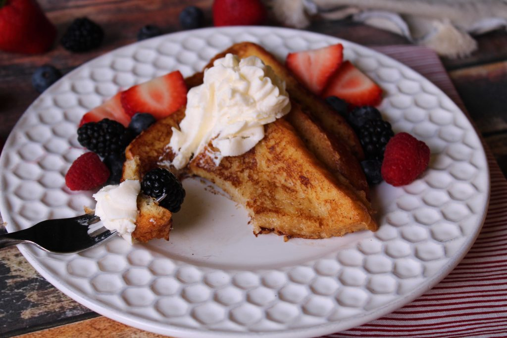 Taking a bite of Brioche French Toast