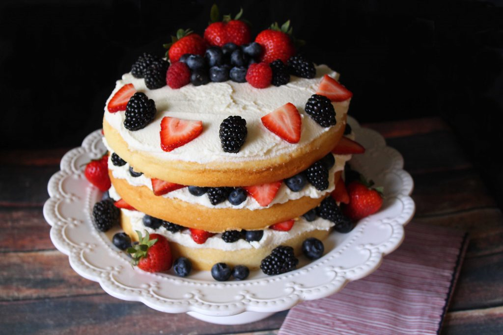 Triple Layer Gentilly Cake dressed with berries