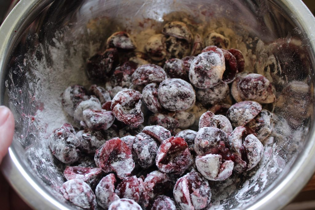 coating fresh cherries with flour