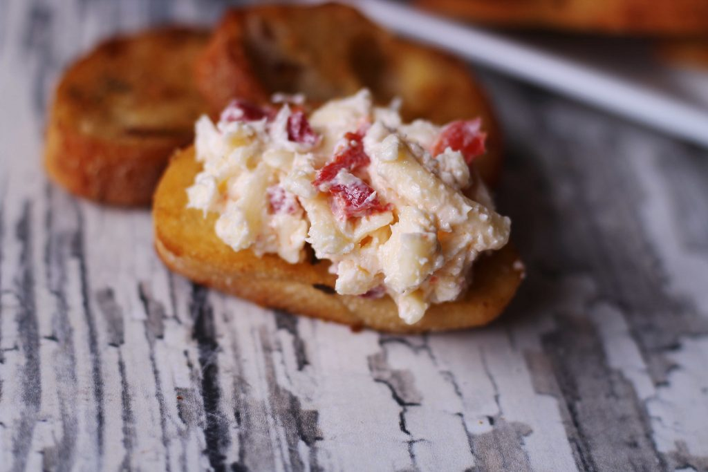 Smoked Gouda Pimento Cheese on a cracker