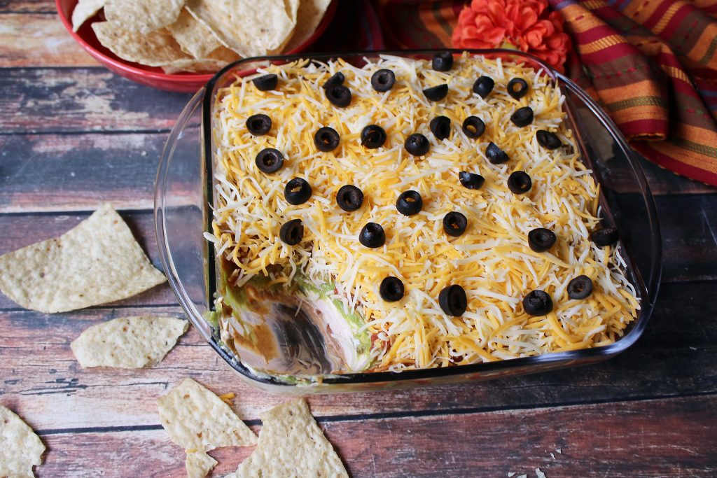 Tex Mex Layered Dip with a serving taken out