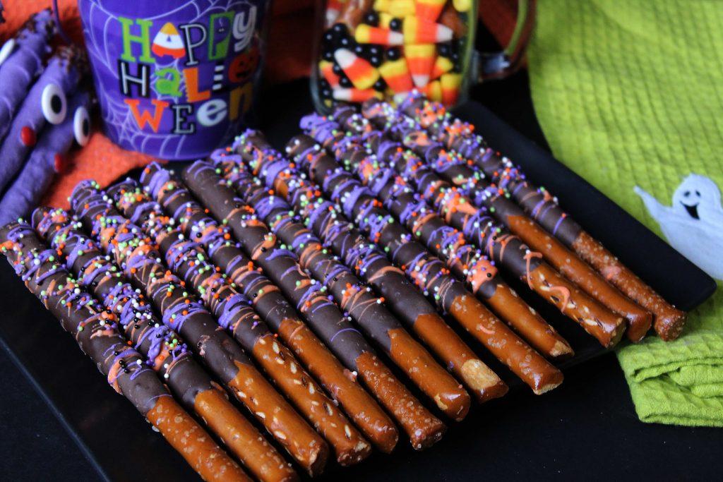 Halloween Pretzel Rods on a plate