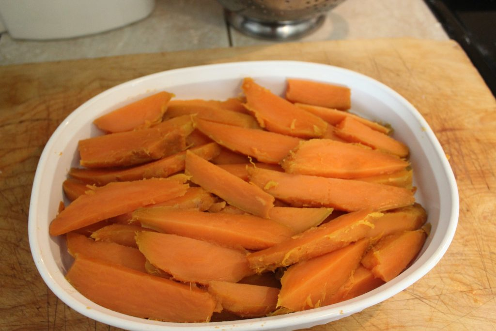 slices of sweet potatoes in baking dish