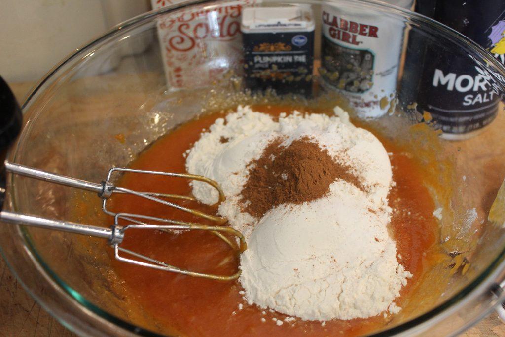 Add dry ingredients to pumpkin
