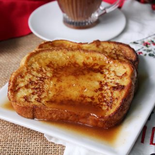 Eggnog French Toast on a plate with syrup