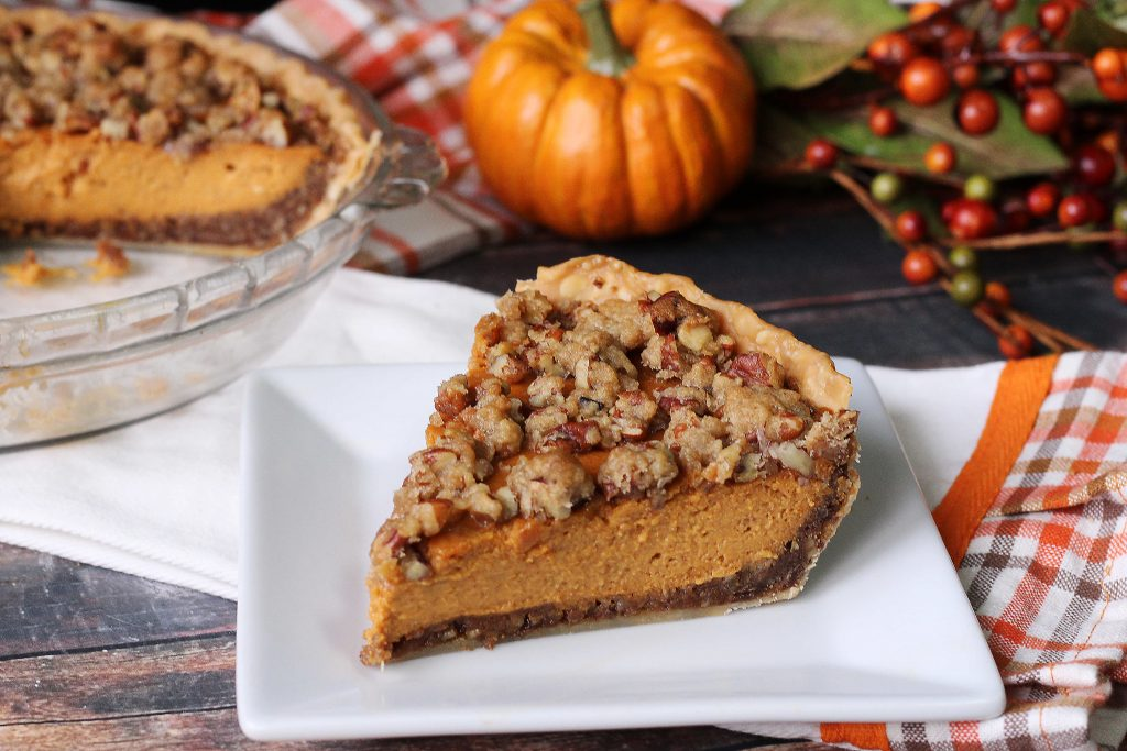 Pumpkin Pie Supreme with a slice taken out