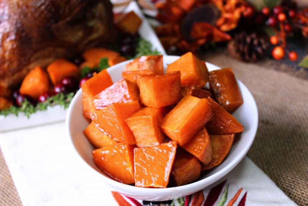 Easy Roasted Sweet potatoes next to a turkey