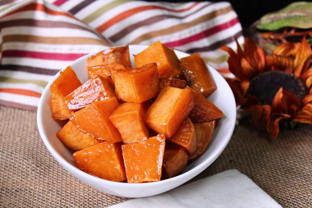 Easy Roasted Sweet potatoes in a bowl next to a napkin