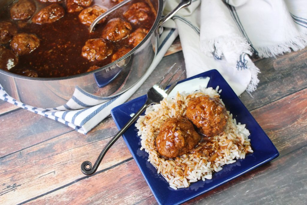 Meatballs and Brown Gravy on a blue plate