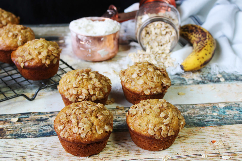 Banana Oat Muffins on table and cooling rack
