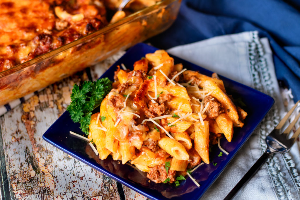 A serving of easy baked ziti on a blue plate