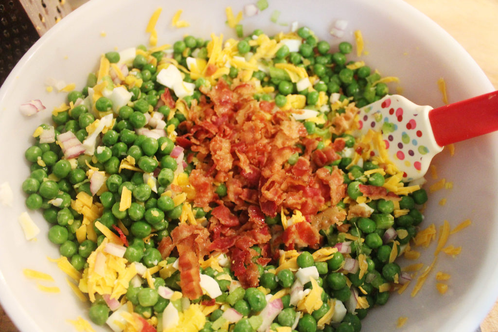 Tossed peas salad with crumbled bacon on top