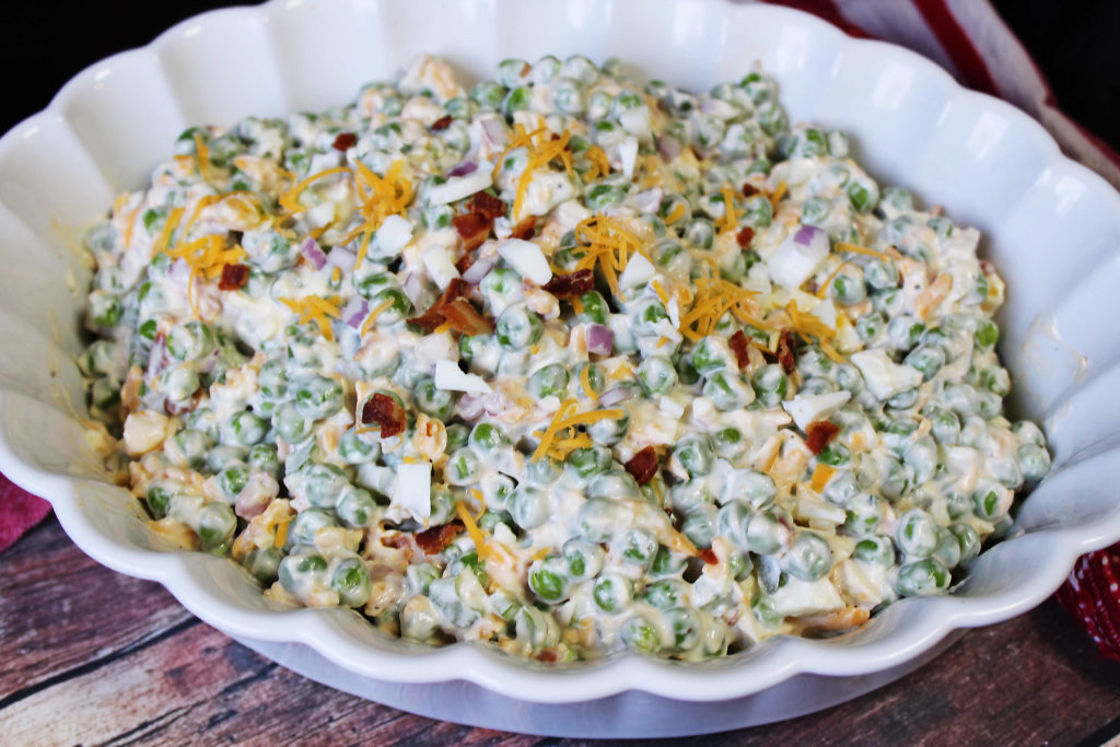 Close up of Old Fashioned peas salad in a white serving bowl