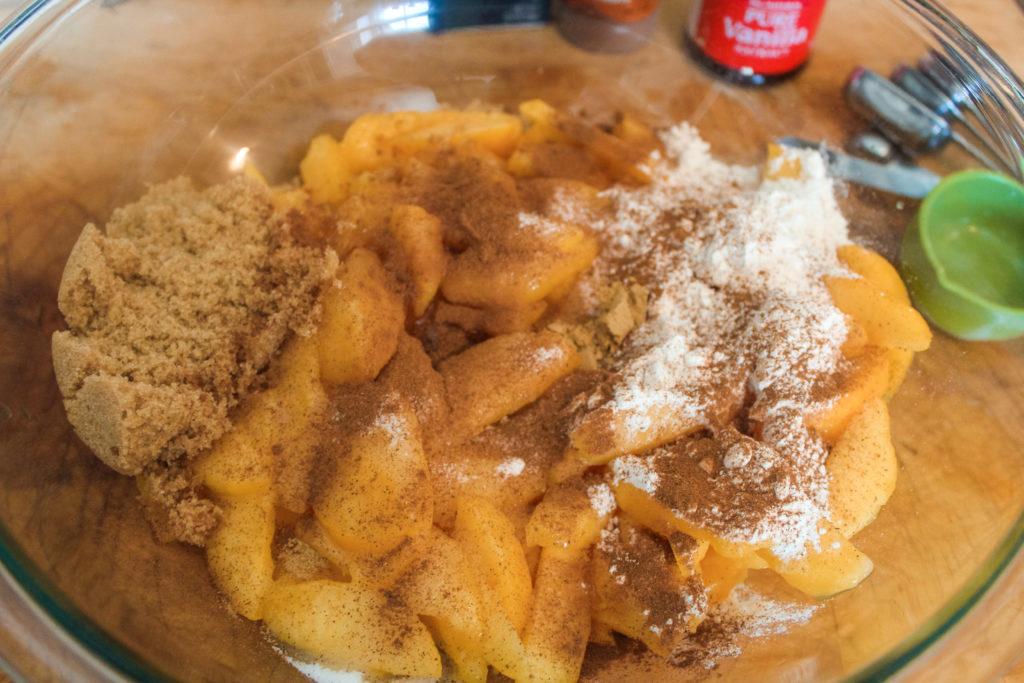 Adding ingredient to the fresh peaches
