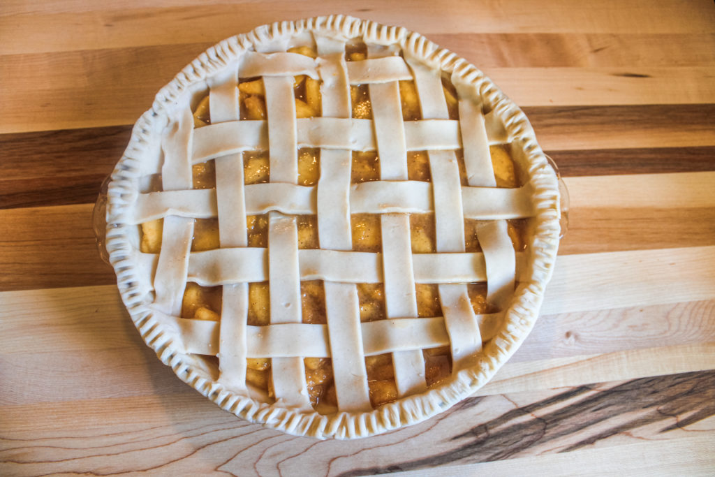 Lattice crust on top of fresh peach pie