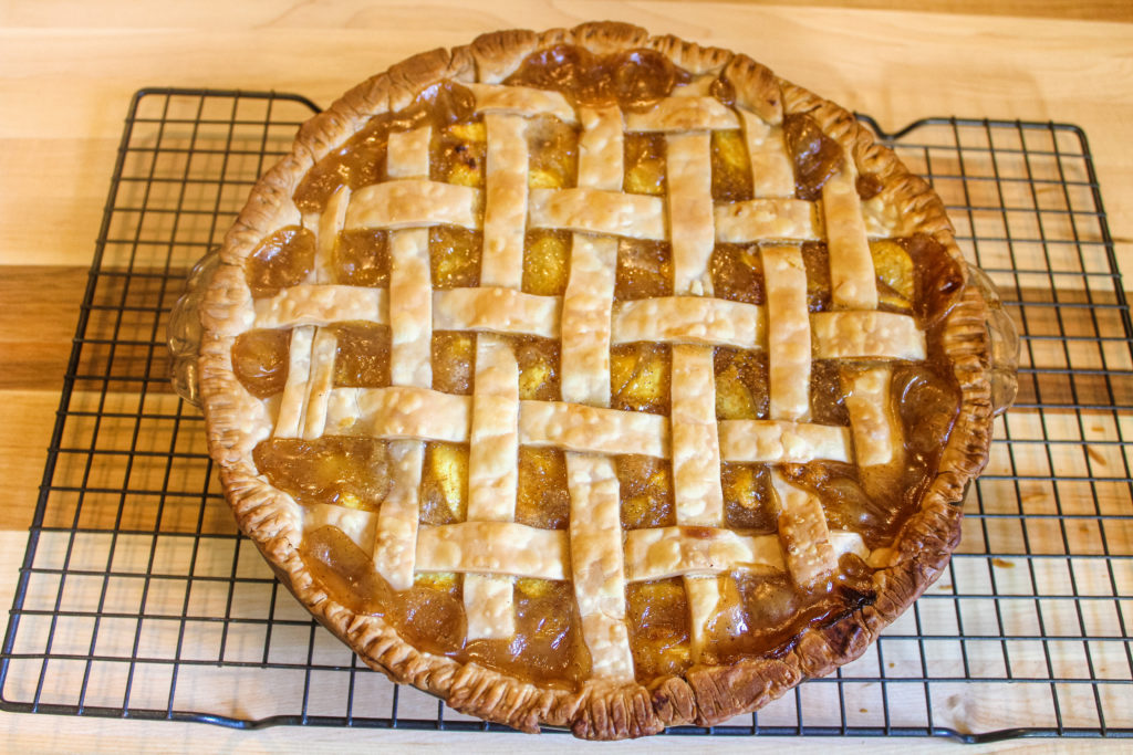 Fresh Peach pie on cooling wire rack
