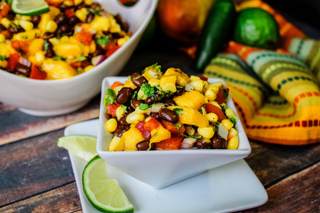 mango black bean salad in a small white bowl