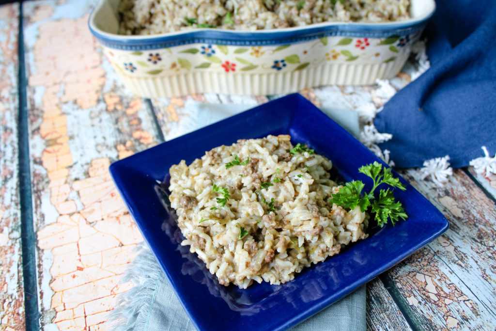 Eggplant Rice Dressing single serving on a blue plate.