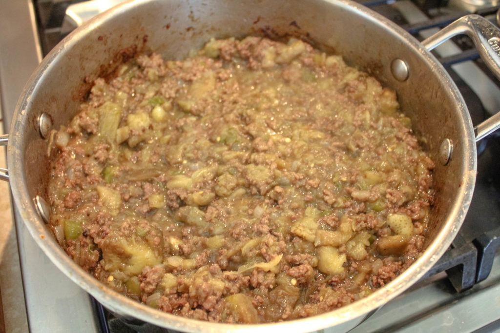 Eggplant cooked down into the the ground meat.