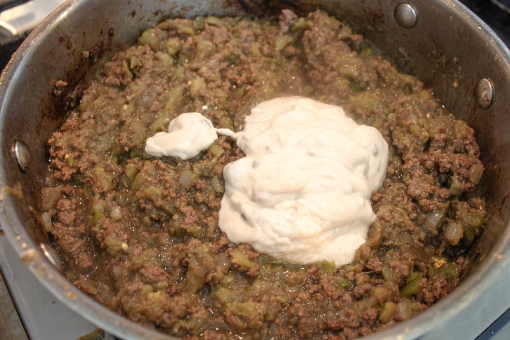 adding cream of mushroom soup to the eggplant mixture.