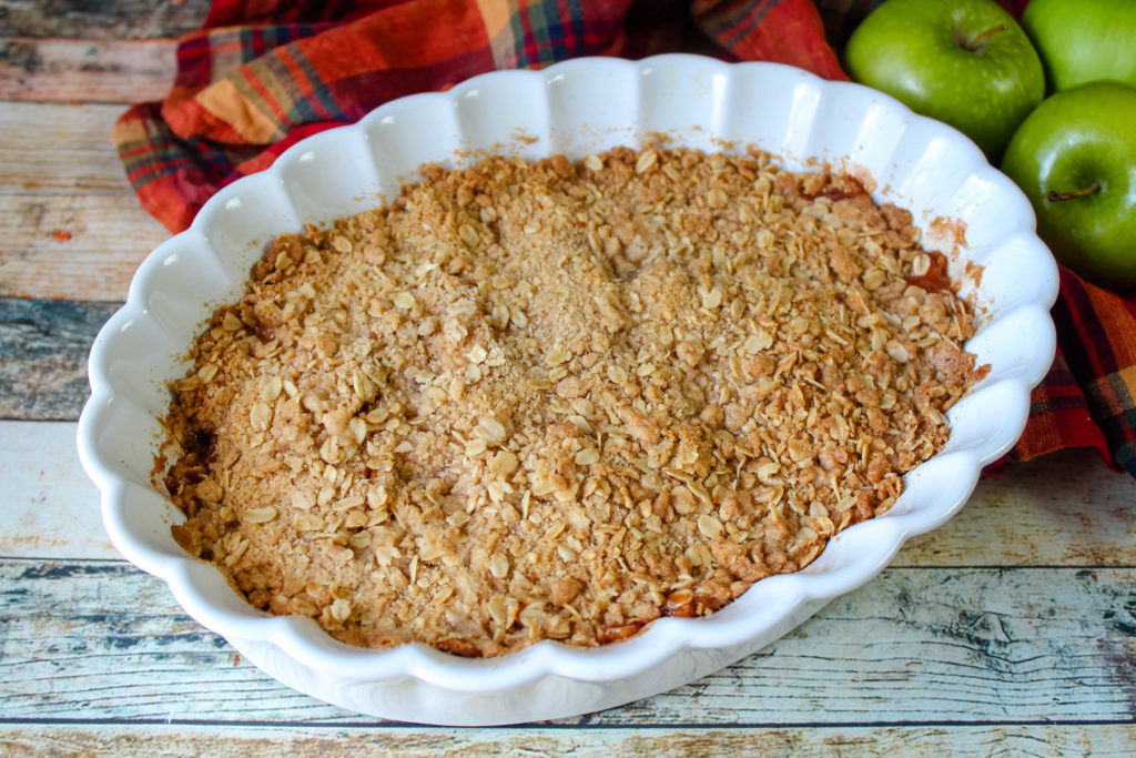 Cinnamon Apple Crisp in a white baking dish