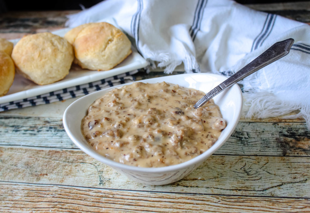 Old Fashioned Sausage Gravy in a white serving bowl