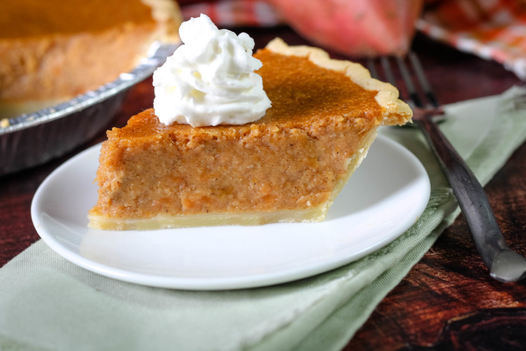 Slice of Southern Sweet potato pie with whipped cream