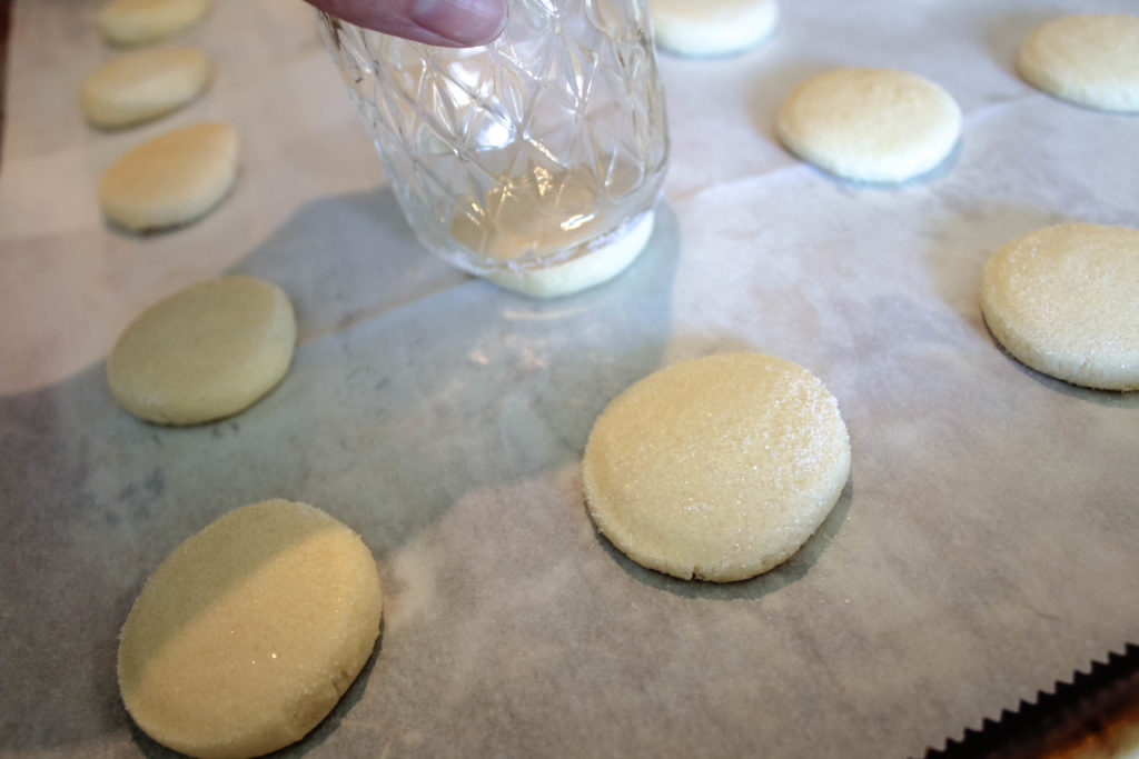 Sugared glass flattening the cookie dough