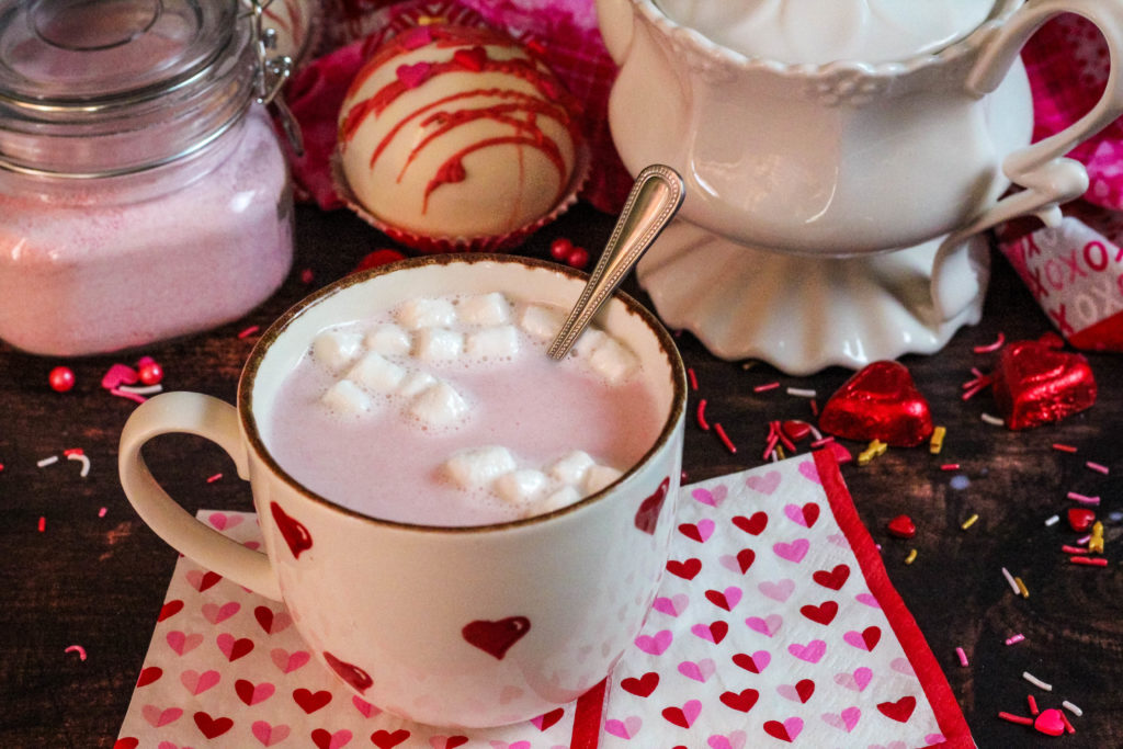 Pink hot Cocoa bomb mixed in a valentine mug