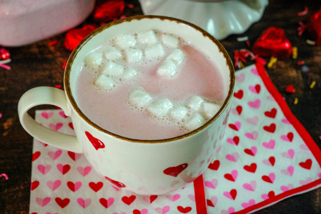 Pink hot cocoa in a mug with marshmallows