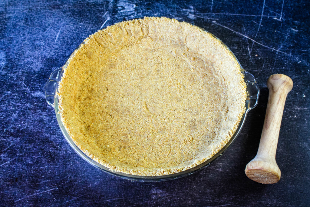 Packed graham cracker crust before baking