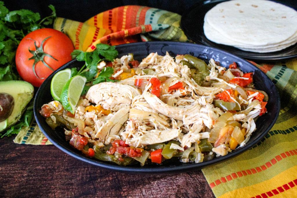 Slow Cooker Chicken Fajitas on a black platter
