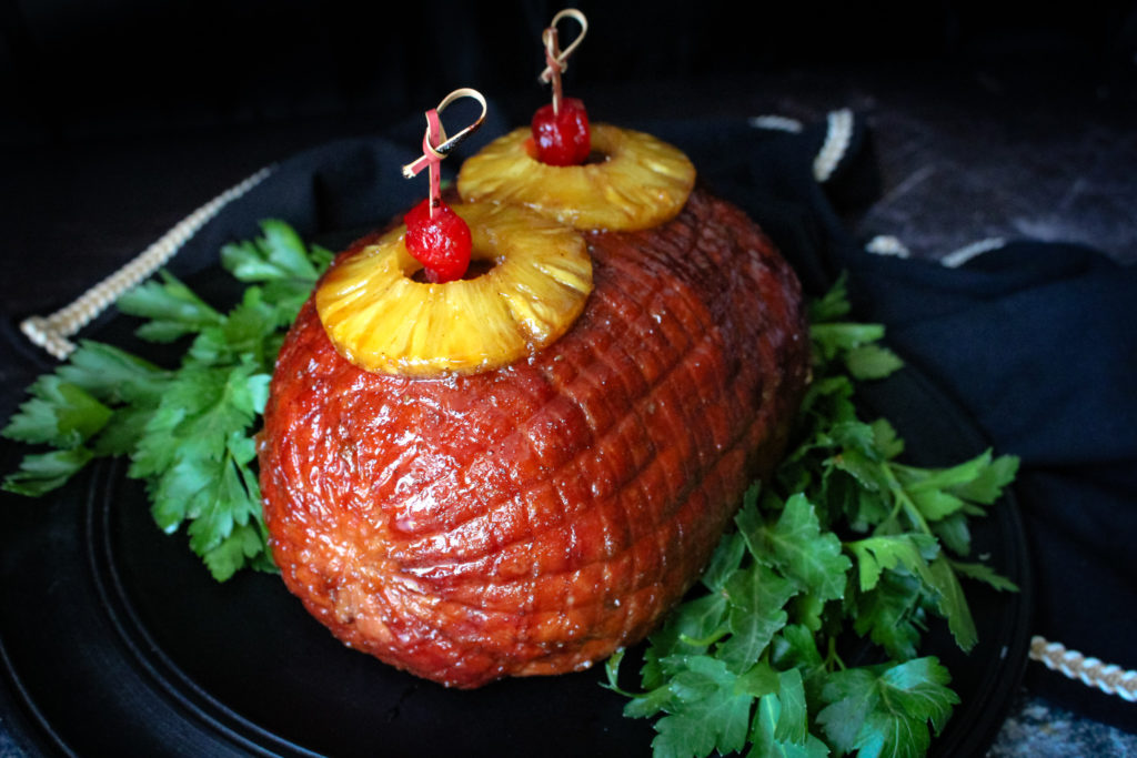 Brown Sugar and Pineapple Glazed Ham whole with pineapple and cherries on top